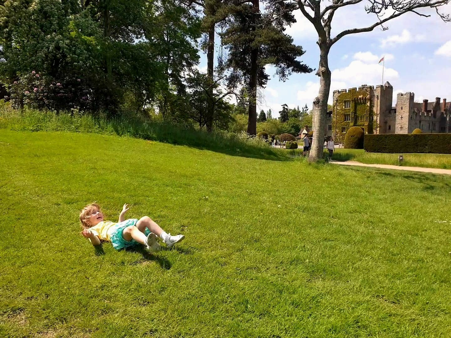 Rolling down grass hill at Hever Castle